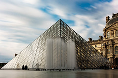 A moment to pause (jwowens) Tags: louvre paris france daylight longexposure fountain water clouds couple