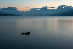 Lake McDonald ((JAndersen)) Tags: lake lakemcdonald glacier glaciernationalpark montana usa mountains water goingtothesun apgar sunrise dawn clouds smoke mist nikon d810 nikkor2470mmf28ged longexposure landscape