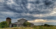 stormy weather... (BillsExplorations) Tags: barn abandoned ruraldecay forgotten abandonedillinois clouds stormyweather sunset farm abandonedfarm discarded polo silo vintage field