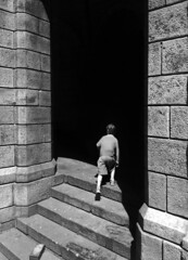 Swallow (Cosmic Oxter) Tags: swllow shadow shadows boy stairs contrast doorway portal inside go street