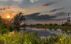 Days of late summer (piotrekfil) Tags: nature landscape sunset sky sun summer clouds water river reflections grass pentax poland piotrfil