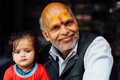 Grandfather and Granddaughter, Uttar Pradesh India (AdamCohn) Tags: adam cohn uttar pradesh india mathura vrindavan grandchild grandfather holi smile wwwadamcohncom adamcohn uttarpradesh