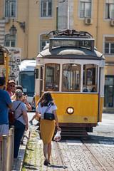 Dressed Code Song (sdupimages) Tags: street lisboa lisbonne lisbon rue tramway yellow white jaune blanc bicolore transport tranportation fun funny candid travel voyage