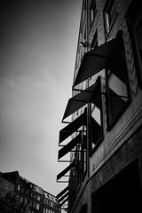 City sails I (iamunclefester) Tags: münchen munich asatouristinmyhometown manualfocus manualfocusday street blackandwhite monochrome city sail canvas facade windows sky tiles