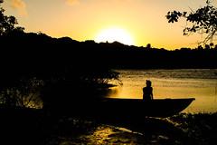 Sunset boat (Rafael C. C. de Souza) Tags: boat sunset afternoon girl people beach sun shadow river caraíva bahia brazil canon 500d sky gold landscape