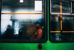 Dreary (ewitsoe) Tags: nikon street urban city man window tram sideview wet raining rainy autumn obscured grain light shadows nikond80 35mm streetstyle cityscape poznan poland ewitsoe