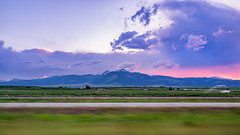 Passing By (Clint Everett) Tags: landscape sunset sky summer drive travel road trip montana mountains country farm rural clouds field
