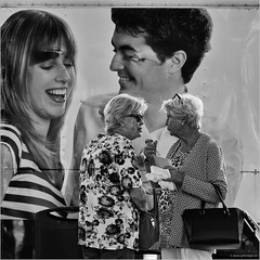 Being watched (John Riper) Tags: johnriper street photography straatfotografie square vierkant bw black white zwartwit mono monochrome netherlands john riper rotterdam fuji fujifilm xt2 18135 candid watched spied ladies poster snack snacking handbags golden girls women