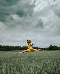 fire cannot put out rain (veldreannija) Tags: jump dancer dancers ballet ballerina umbrella rain storm fire dress field fine art photography annija veldre