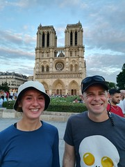 Andrew & Stephanie happy to start sightseeing in Paris in front of Notre Dame.