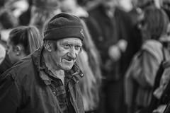 A hint of a smile (Frank Fullard) Tags: frankfullard fullard candid street portrait monochrome black white ballinasloe fair galway smile happy blanc noir expression face cap knitwear knitted