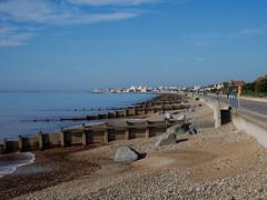 Strolling in the October Sun (DaveC...) Tags: lumixvario1260mm lumixdmcg80 felpham promenade shingle seaside breakwater bluesea bluesky strolling butlins bognorregis calm sea calmsea