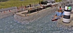 Dunstan Harbour. (ManOfYorkshire) Tags: dunstanhrabout scale 176 oogauge model railway train layout ferry farne islands harbour choppy rough sea station steam engine loco locomotive passenger arrival 2934 lner celestory stock coaches locomotion shildon exhibition show 2018 lightbouse keeper watching angry clerestory