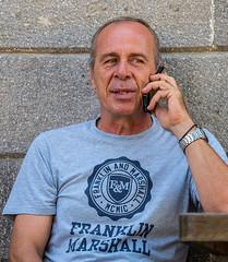 On The Phone ( Candid) Cafe Dali - Myrina Town - Limnos (Olympus OM-D EM1-II & M.Zuiko 40-150mm f2.8 Pro Zoom) (1 of 1) (markdbaynham) Tags: lemnos limnos greece greek hellas hellenic greekisland greekholiday greektown grecia greka gr oly olympusgreece olympusomd mft olympusem1 olympusmft m43 mirrorless csc evil micro43 microfourthird microfourthirds 40150mm telephoto olympuspro m43rd mzd zd mz mzuiko zuikolic prozoom zoomlens f28 em1 em1mk2 em1ii