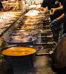 Paella production line (tokyobogue) Tags: tokyo japan streambuilding nikon nikond7100 d7100 sigma sigma1750mmexdcoshsm urban city people restaurant paella cooking