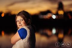 Megan at Sunset [Explored] (Adrian Court LRPS) Tags: blue buildings caldecottelake children dress family flash hss kids lake megan miltonkeynes orange reflections sunset england unitedkingdom gb