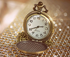 Time is Gold (Through Serena's Lens) Tags: smileonsaturday copyrightbymankind watch pocketwatch timepiece stilllife closeup vintage bokeh dof sparkle time analog chain tabletop