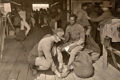 Great care is giving correct shoe size. Office inspects each recruit after receiving uniform, Camp Meade MD Oct 4, 1918 NARA111-SC-021001-ac (SSAVE over 12 MILLION views THX) Tags: campmeademd ww1 worldwari 1918 induction usarmy soldiers recruits africanamerican black segregation