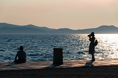 Posed (sarah_presh) Tags: croatia europe holiday vacation zadar seafront sea ocean people silhouette couple camera photographing outside outdoor relaxation tourist nikond750 posed pose muted oldpolar lightroom