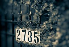 Siebenundzwanzigfünfunddreißig (Katrina Wright) Tags: dsc2059edit2 fence numbers 2 7 3 5 2375 bush garden pattern line sign housesign ceramic tile dof monochrome bokeh hff hmbt
