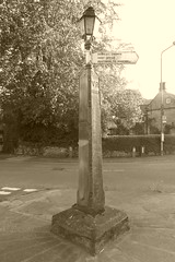 Signpost, Rowsley (dave_attrill) Tags: signpost roadside street junction rowsley bakewell village peakdistrict nationalpark derbyshire sepia