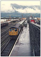 Rainy day in Kyle (david.hayes77) Tags: type2 sulzer brcw class26 26032 scotland scottishhighlands kyleoflochalsh 1977 fordtransit isleofskye rain port