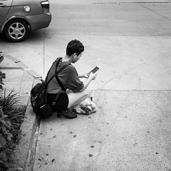 The only one... (Go-tea 郭天) Tags: qingdao huangdao shandong mobile phone network connected connexion data cellular cell cellphone woman young lady back backside backpack bag shopping seat sit floor road break check checking addiction addicted cars exclusion virtual alone lonely street urban city outside outdoor people candid bw bnw black white blackwhite blackandwhite monochrome naturallight natural light asia asian china chinese canon eos 100d 24mm prime