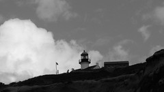 Under One Flag (Rand Luv'n Life) Tags: odc our daily challenge cabrillo national monument park light house under one flag silhouette clouds sky monochrome blackandwhite point loma san diego california
