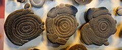 speak-- hear-- and see-no-evil (subarcticmike) Tags: subarcticmike travel museum clay fragments abstract naturesart geology 6ws sixwordstory geotagged geotourism coasters babies buttons natural