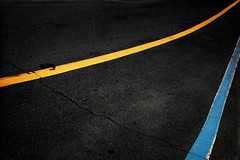 composition - 10 (Rino Alessandrini) Tags: asphalt street dividingline road traffic nopeople transportation urbanscene lane outdoors roadmarking singleline blackcolor backgrounds striped yellow highway sign citylife white