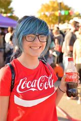 Audra chooses Coke (radargeek) Tags: okc oklahomacity oklahoma plazadistrict dayofthedead 2018 october bluehair smile kid child children kids portrait coke cocacola