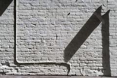 painted brick #1 (queue_queue) Tags: alpha7 a7 minoltamcrokkorxpg50mmf14 rokkor wall paint street sidewalk texture surface sunlight