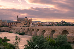 In love with Cordoba (Mariano Colombotto) Tags: cordoba andalucia andalusia españa spain travel sunset sky clouds cathedral mosque arquitectura architecture river bridge puente city water tones nikon photographer photography