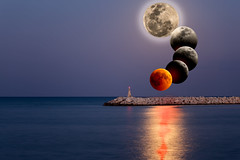 Conceptual compoite image of the stages of the largest lunar eclipse of 21 century. (ABglavin) Tags: astronomy background beach beautiful blood century coast compositeimage computergeneratedimage concept cyprus dark digitalpainting dusk eclipse europe event full greece horizon island landscape larnaca larnaka light longest lunar mediterranean moon moonglade moonlight nature night ocean orange outdoor red scenic sea shore sky solar space summer total tourism travel view water yellow