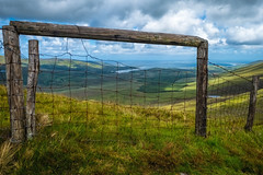 conor pass through the fence (-liyen-) Tags: conorpass fence ireland dingle dinglepeninsula summer lakes beautifulview fujixt2 landscape clouds sunny challengeyouwinner mpt678 matchpointwinner