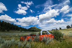 Graveyard For Cars - Big Sky Country (Pete Nunnery) Tags: canon nature clouds color geodata flickr green ngc image sky mountains mountain montana orange photo photography photographer shadows sunlight blue abigfave