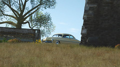 Keeping Watch (Mr. Pebb) Tags: side front stockshot stock american car northamerican classic forddivision mercurycoupe coupe mercury rwd rearwheeldrive frontengined frontengine fr 4seater fourseater 2door 2seater photomode racinggame racegame forza forzaseries forzahorizon4 fh4 forzahorizon playgroundgames pg microsoftstudios microsoftgamestudios firstpartygame firstpartytitle 1stpartygame 1stpartytitle 4k 4kgaming 3840x2160 169 landscapeformat landscapemode xboxone xboxonex xbox ms microsoft turn10studios t10 turn 10 videogame videogamecapture screencapture screenshot imagecapture day daytime colour color colourshot colorshot colourimage colorimage colorpicture colourpicture afternoon old buildings building tree