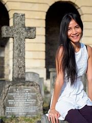 Vicky (Brompton Cemetery) (Torsten Reimer) Tags: memorial friedhof europa people sitting london graves gravestone gravestones cemetery grabsteine frau unitedkingdom bromptoncemetery grabkreuz grabmal longhair graveyard arches woman grab england olympusomdem10 portraits europe uk smile gb