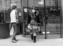 Entrance of the Morris Dancer (Bury Gardener) Tags: bw burystedmunds blackandwhite britain england eastanglia suffolk streetphotography street streetcandids snaps strangers candid candids people peoplewatching folks 2018 nikond7200 nikon uk arc thearc