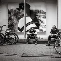 having a break (Gerard Koopen) Tags: nederland netherlands amsterdam capital city people man workingman cigarette smoking fashion woman girl hat beautiful poster straat street straatfotografie streetphotography streetlife urban bw blackandwhite blackandwhiteonly sony sonyalpha a7iii 2018 bike gerard koopen gerardkoopenphotography