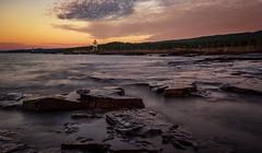 Lake Superior (reinaroundtheglobe) Tags: lakesuperior minnesota grandmarais lowangleview longexposure lighthouse coastline lake sunrise rocks landscape tranquility nopeople