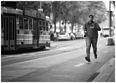 The commitment (gro57074@bigpond.net.au) Tags: commitment tram running flindersstreet cbd melbourne streetphotography candidstreet candid mono monotone monochrome blackwhite bw d850 nikon 105mmf14 artseries sigma