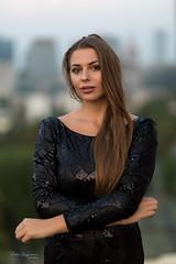 Posing on a roof (piotr_szymanek) Tags: kornelia korneliaw woman young skinny outdoor portrait face eyesoncamera longhair black dress skyline city roof 1k 20f 50f 5k 100f 10k 20k 30k 40k