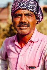 Indian Man in Pink Gulal for Holi (AdamCohn) Tags: 044kmtonaglaprbiyainuttarpradeshindia abeer adamcohn india kmtoin naglaprbiya uttarpradesh colors geo:lat=27196660 geo:lon=78530908 geotagged gulal holi streetphotographer streetphotography wwwadamcohncom अबीर गुलाल bernisinora