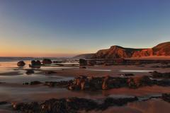 The Suns Getting Low Now (Mark Wasteney) Tags: sunset glow rocks beach landscape seascape sea seaside sand sandymouth cornwall kernow