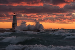October Knight (Aaron Springer) Tags: michigan northernmichigan lakemichigan thegreatlakes frankfortlighthouse weather gale waves pier lighthouse sunset october autumn fall outdoor nature seascape