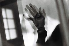 la main de l'un le visage de l'autre (asketoner) Tags: face hand window glass reflection double portrait woman eye binn switzerland winter snow daylight sauna expression