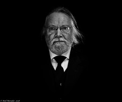 What did he see ? (Neil. Moralee) Tags: neilmoralee butler servant man face portrait black white bw bandw mono monochrome contrast hair beard glasses moustache old mature manservant majordomo estate dark neil moralee olympus omd em5 lowlight highiso blackbackground tie shirt lanhydrock blackandwhite