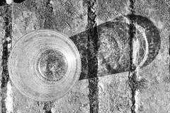 glass reflexes (Cosentino Aran) Tags: glass blackandwhite monocromatico reflextion sun dark light reflections life art strange talent glasses