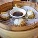 Lucky 12 - Stack of 3 Sui Mai with black vinegar chicha de jora dipping sauce (Chifa). DORADO-Pork, Shrimp, jicama, shiitake mushroom, peanut topped with golden egg